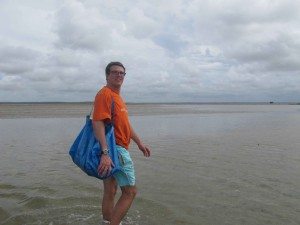 Heading for sampling on a sand flat with seagrass (Barra estuary, Inhambane, Mozambique)